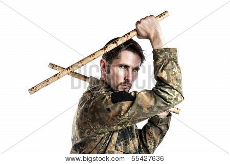 Male self defense instructor with camouflage do a self defense exercise with bamboo sticks isolated on white background poster