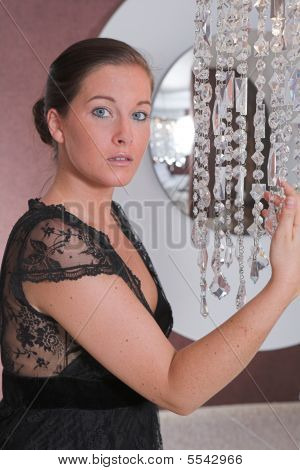 Young Attractive Woman Posing In Front Of A Mirror