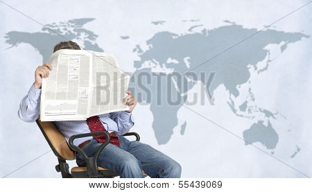 A businessman stockbroker reads the finance newspaper