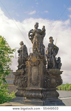 Ancient Sculpture On The Charles Bridge. Prague. St. Barbara, Margaret And Elizabeth
