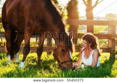 horse and woman in pasture