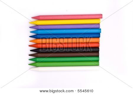 Arrangement of many colorful wax crayons