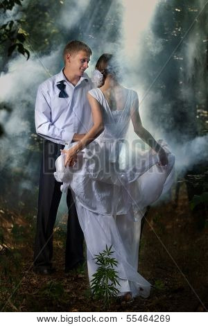 A young beautiful couple in a forest