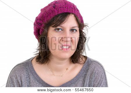 Nasty vindictive woman with a cold mean stare looking at the camera with a sneer head and shoulders isolated on white poster