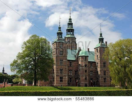 View of the Rosenborg Castle which is a renaissance castle at the Royal Garden in the center of Copenhagen Denmark. poster
