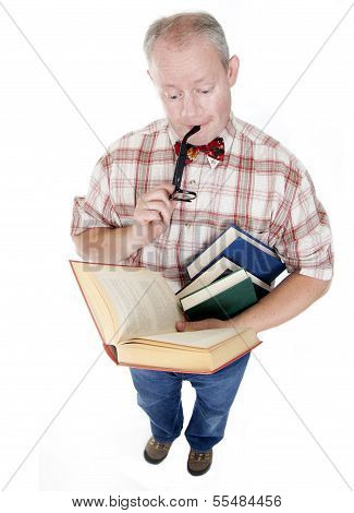 Middle Aged Man Reading A Book