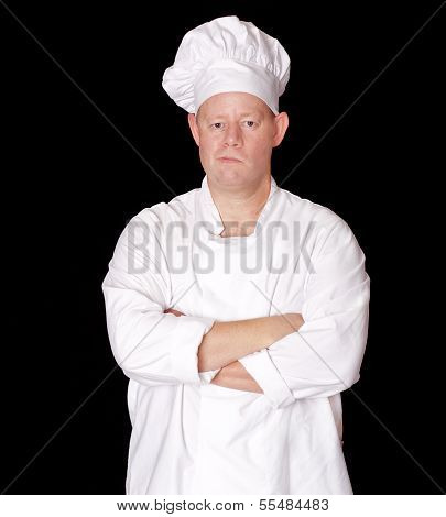 Male Chef With Arms Crossed Isolated On Black Background