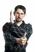 Man in combat dress do a self defense exercise with knife poster
