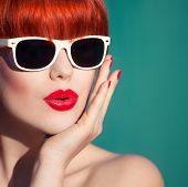 Colorful summer portrait of an attractive young woman with sunglasses poster
