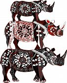 three patterned rhinoceros in ethnic style on a white background poster