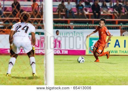 Sisaket Thailand-may 21: Tatree Siha Of Sisaket Fc. (orange) In Action During Thaicom Fa Cup Between