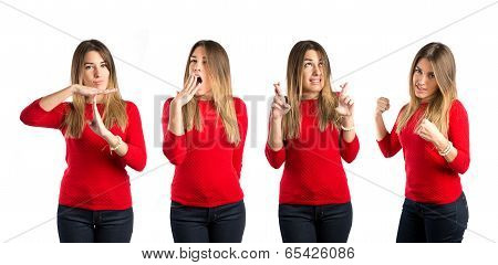 Young Girl Crossing His Fingers, Making The Time Out Gesture Over White Background