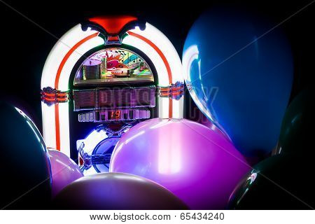 Neon white jukebox with party balloons