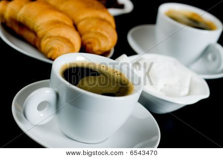 Cup Of Black Coffee With Croissants