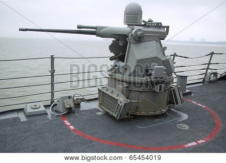 MK-38 25mm chain gun aboard the guided-missile destroyer USS McFaul during Fleet Week 2014