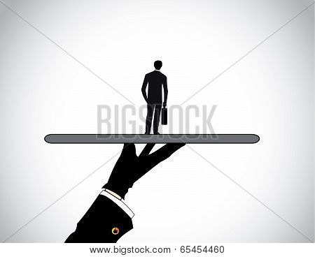 A Head Hunter's Hand Silhouette Presenting A Dressed Professional Business Man