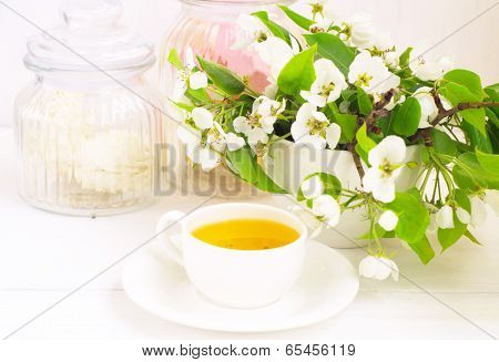 Cup Of Tea And Apple Flowers