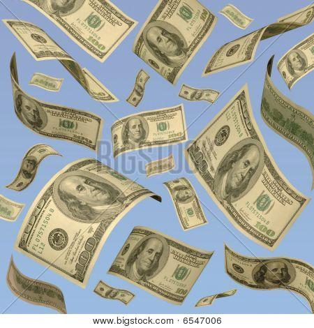 One Hundred Dollar Bills Floating Against A Blue Sky.