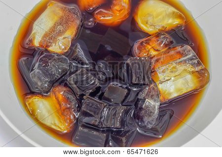 Choa Kuay Grass jelly in a cup with ice syrup ready to eat at the restaurant poster