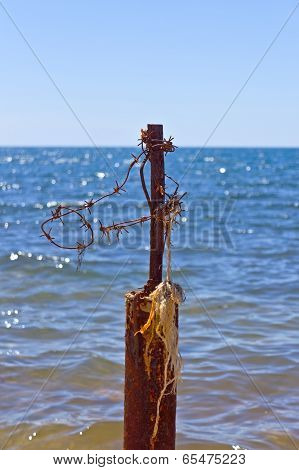 Barbed Wire And Blue Sea