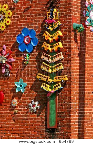 Whimsical Sculptures On Wall