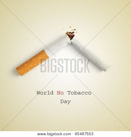 the sentence World No Tobacco Day and a broken cigarette on a beige background