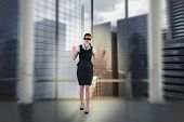 Composite image of redhead businesswoman in a blindfold walking through crowd poster