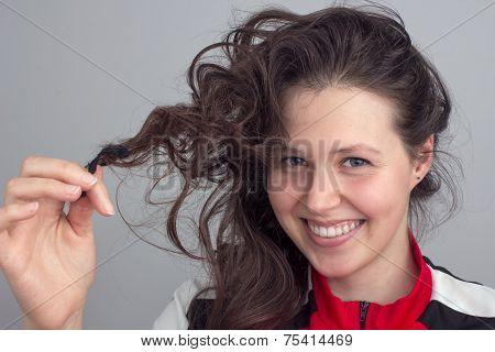 Smiling Girl's Face And Hand Tousling Hair