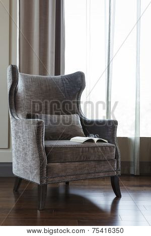 Armchair with Book and Eyeglass room interior decoration