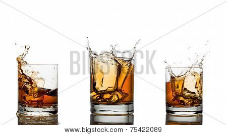 Whiskey splash in a glass, isolated, white