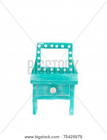 Handmade blue toy bureau.