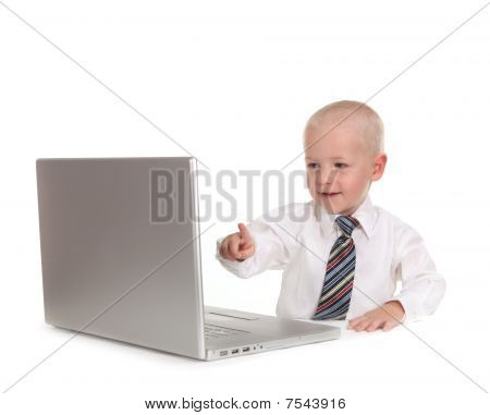 Little Business Prodigy Using A Laptop Computer