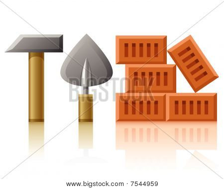 building tools hammer trowel and bricks