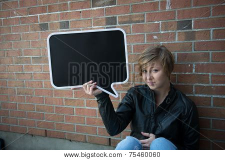 Teen holds sign for your text