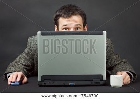 Frightened People Hiding Behind Computer Screen