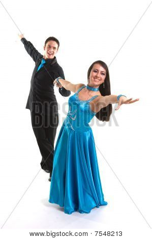Young ballroom dancers in formal costumes posing against a solid background in a studio poster
