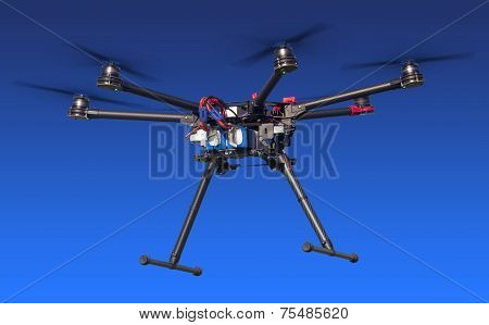 Dlying drone isolated on blue
