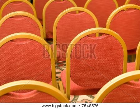 Rows Of Red Chairs In The Conference Hall