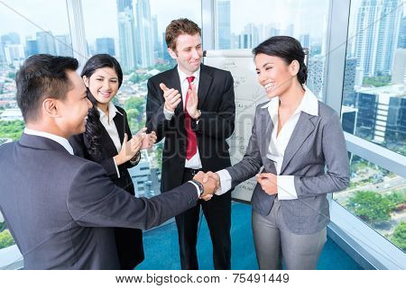 Asian Business Team - applause after an successful presentation in the office
