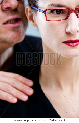 Man Whispering Nastily Venom In Woman's Ear