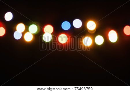colored glare from garland on a dark background poster