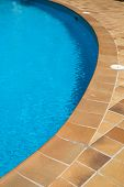 image of the edge of a swimming pool poster