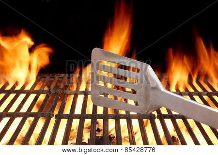 Hot Bbq Grill Tools In The Flame