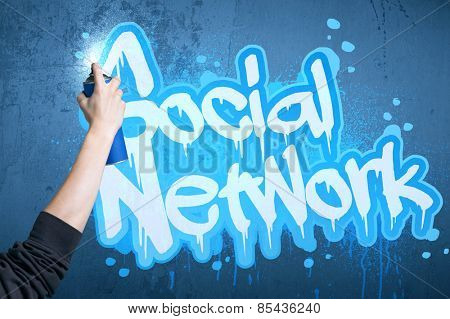 Hand drawing a social network subtitle on the wall