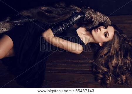 beautiful Woman With Dark Hair In Luxurious Fur Coat And Leather Gloves