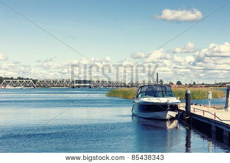 The Boat Is At The Dock On The River On A Summer Day