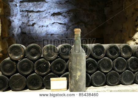 Old Bottle Of Wine In The Cellar Of The Winery Ancient Wine Bottles In The Cellar Wineryred Wine Of
