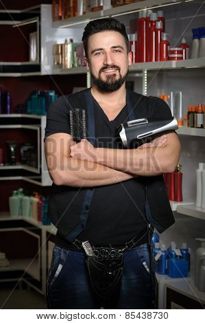 Handsome professional hairdresser man