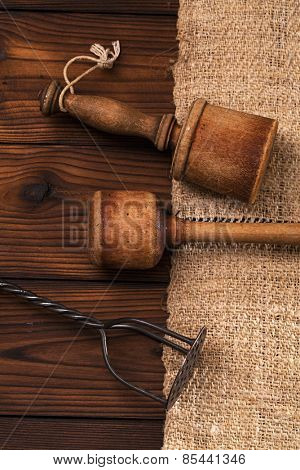 real vintage wooden and iron mashers on old grain sacking linen Completely hand made  handwoven and homespun