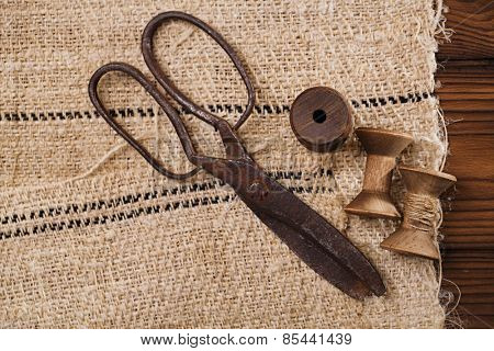 really antique iron scissors with spools on old grain sacking linen Completely hand made  handwoven and homespun
